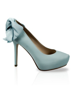 Light blue silk pump features bow detail. Also customizable in various colors, fabrics, and heel heights.