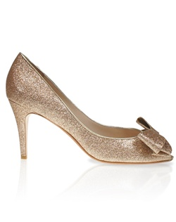 Gold glitter peep-toe pump features bow detail. Also customizable in various colors, fabrics, and heel heights.