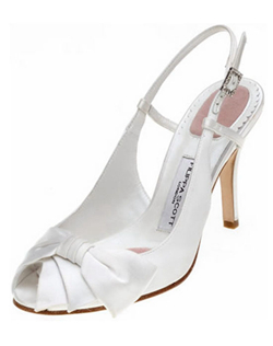"""Luxurious silk satin gives Celicia's bow a fantastic sheen in your choice of dyeable white or ivory. The slingback is set with a rhinestone buckle and a bit of elastic so you can adjust it for a comfortable fit. Heel measures 3.5""."