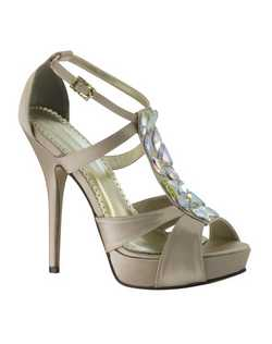 "The Johnathan Kayne Antarctica shoes are the ultimate neutral heel. The Champagne materials are neutral enough to go with almost any attire. The fun strappy design and embellished T-strap features iridescent gem stones. The 4 1/4"" heel is balanced in the front with a 3/4"" platform as well as a wider strap to keep you comfortable."
