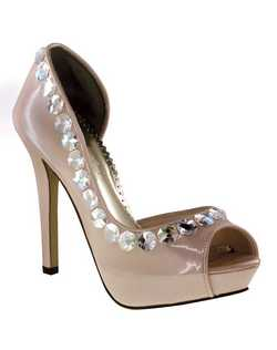 """Pearlized patent peep toe platform pumps featuring Aurora Borealis crystals and smoked or clear jewels all along the edging. A truly unique style with a 4"" heel and 1"" platform front. Available in Pearlized Pewter and Pearlized Champagne patent leather."""