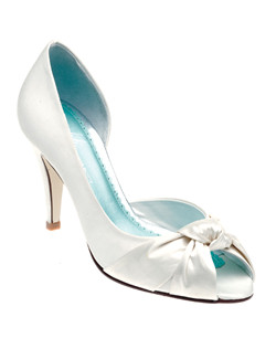 """Knotted silk satin gives these pumps a bit of sophisticated detail. Available in ivory, the heel measures 3.25"". This shoe is not dyeable."