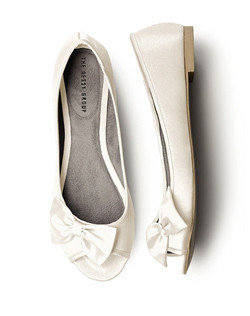 """Adorable peep toe satin flats with off set bow design. This style is perfect for the Bride who is looking for comfort and style. The flexible design and sweet accent make this style a must have."