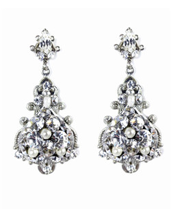 "The Belflower earrings are a fresh twist on antique styling. These large silver spade filigree are encrusted in Swarovski rhinestones and accented with Swarovski pearls in pale ivory. Dimensions: 2 1/4""L; 1"" W at widest point"