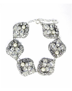 """The Midori bracelet features spade filigree accented with Swarovski rhinestones and pearls. A beautiful marriage of pearls and rhinestones! Dimensions: 7"""" L with 2"""" extender; 1"""" W"""