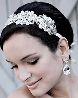 This Swarovski floral stamped headband combines ethereal beauty with vintage glamour. Adorned with Swarovski mirrored crystals for stand out sparkle. Ribbon is shown throughout design for an elegant finish. Available on ribbon (shown) or metal frame. Ribbon available in ivory or diamond white.