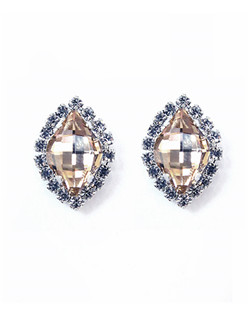 "Sparkling faceted marquis studs shine in silk Swarovski crystal accented with a clear bezel. 3/4"" L, 1/2 W"