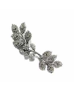 An elongated vine accented with Swarovski floral and leave crystal decor throughout, this is a versatile piece!