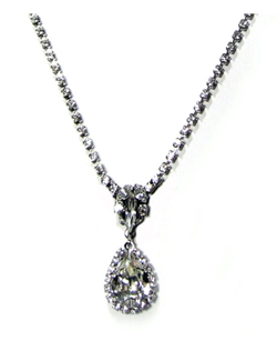 "Swarovski crystal teardrop accented with a clear bezel suspended from a Swarovski rhinestone chain. 16"" L with 2"" extender"