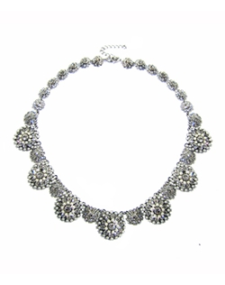 Delicate necklace set with Swarovski elements crystals accented with crystal sparkle and give a vintage glam feel. A great statement piece with complementing pieces to finish your look. Available in rhodium (silver) or gold.