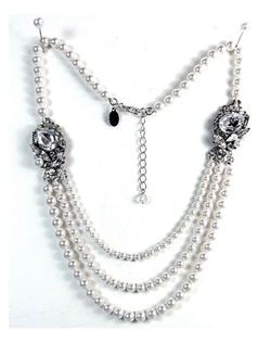 A classic 3 strand pearl necklace by Ti Adoro Jewelry with a vintage glamour twist! Exquisitely handcrafted with three strands of Swarovski pearls accented with Swarovski crystal-encrusted adornments on each side.