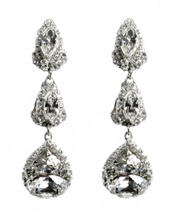 "These Swarovski 3 tier chandelier earrings are truly spectacular. Set on sterling silver filigree, oval and navette Swarovski rhinestones sparkle to be the perfect statement earrings! These earrings are as beautiful from the back as they are from the front. Silver filigree settings and the special ""something blue"" crystals adorn the back of these beautiful earrings! Dimensions: 2.5"" L; 3/4"" W at widest third drop."