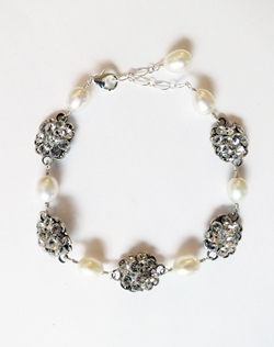 "Classic and elegant! Sterling silver filigree encrusted with Swarovski crystal rhinestones and spaced with oval freshwater pearls. Dimensions: 7"" L with 1"" extender."