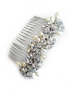 "Classic elegance defined. This vintage inspired comb is a perfect statement piece for many different hair styles. Pale ivory Swarovski pearls combined with prong set Swarovski rhinestones create a glamorous hair comb. Available set in sterling silver or 18K gold plate. Dimensions: 3 1/2"" Long."