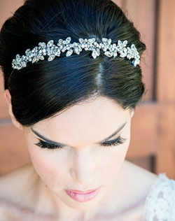 A classic sparkling headband that is perfect with and without a veil...hair up or down. This is a real sparkler! Swarovski Crystallized rhinestone elements encrusted with sparkle vine detail. Available in Silver and Gold. Height: 3/4""