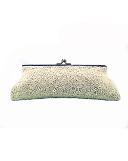 As seen in Martha Stewart weddings, this crystal beaded clutch is exquisite. Silk clutch with confetti beading (mix of cut and caviar beads) which creates a more textured feel. It has an inside pocket with a chain that can be inside or outside.
