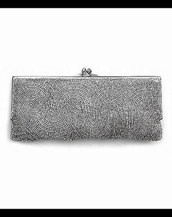 "As seen in The Knot and Martha Stewart Weddings in ""Fancy handbags for the bride, mothers, or bridesmaids blend fashion with function"". This glass beaded clutch is classic and elegant and can be used with an evening gown and or with jeans and a silk blouse!"