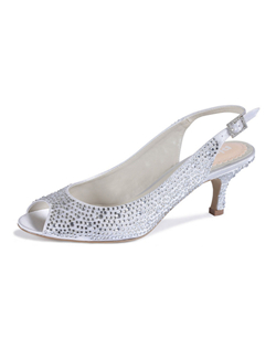 "The Glimmer by Pink is a great low style that lacks no style. The full encrusted design glitters with every step and also offers comfort. The basic peep toe slingback design is simple yet striking. The heel measures 2 1/4"" and is available in a light Ivory which also works well with darker white shades."