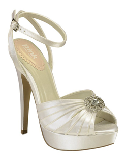 "The multi-strap design and center filigree brooch accent work perfectly together. The 4 3/4"" heel is complimented with a 1"" platform and ankle strap for comfort and stability. Available in dyeable white and ivory."