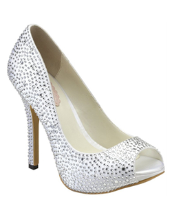 "The Luxe by Pink makes a sparkling statement. The fully closed pump design is complimented with an updated platform front and 4 1/4"" heel. The Luxe style is encrusted in glittering rhinestones all over the vamp and fully up the heel. Available in Ivory."