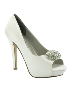 "The Liz Rene Doris is the classic bridal pump with an update. The versatile dyeable white silk materials allow you to tint the style to any shade. The gorgeous crystal brooch at the to reflects the light for a dazzling effect. The 4"" heel is perfectly balanced with a 3/4"" platform front. Available in dyeable white silk."