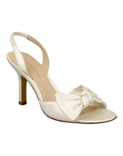 """A bow tied across the toe gives this slingback a laid-back style that's a great look for a garden or beach wedding. The slingback is made with a bit of elastic for slip-on comfort. Available in white or ivory satin, this shoe is not dyeable. Heel measures 2 3/4"".See how Brianna Leigh measures heel height."