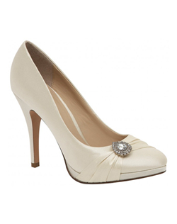 """Updated and sophisticated this style features a small platform front and slightly almond toe. The front is beautifully adorned with a fabric sashand brooch detail. The 3"" heel is practical and comfortable. Available in white and ivory.See how Brianna Leigh measures heel height."