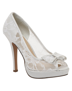 """Sexy sheer lace peep toe pumps with double layer bow detail at the toe. The elegant lace fabric is not only beautiful but soft and supportive. The 4"" heel is balance in the front by a 1/2"" platform for added comfort and balance. Available in white and ivory."