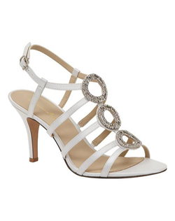 """Strappy and sexy sandals with rhinestone encrusted ornament design up the vamp. These sandals feature slim cut side straps and a sparkleing front design that will grab all the attention. The not to high 3"" heel allows for a long day of wear in this strappy style. Available in white and ivory."