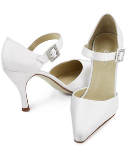 """A bold take on the old-fashioned Mary-Jane with a chunky jeweled buckle and feminine tapered 3.5"" heel. Crafted with luxurious silk satin in your choice of white or ivory. This shoe is not dyeable."