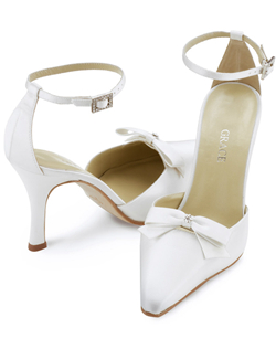 """A satin bow with crystal accent floats atop the vamp of this sassy style in your choice white or ivory. The ankle strap closes with a rhinestone buckle and the heel measures 3.5"". This shoe is not dyeable."