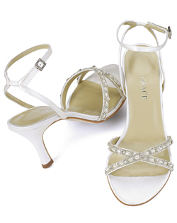 """The intricate pearl and silver beading makes this sandal extra special. The combination slingback and ankle strap has a bit of elastic in back for a comfortable, personalized fit. Tapered heel measures 3.25"". Made of fine silk satin in your choice white or ivory. This shoe is not dyeable."