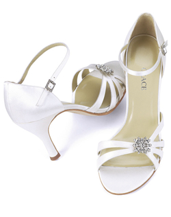 """This hip, asymmetrical design is made even more fabulous by the sparkling jewel at the toe. The adjustable strap with rhinestone buckle gives you a comfortable, personalized fit. Made from fine silk satin in your choice white or ivory with a 3.5"" heel. This shoe is not dyeable."