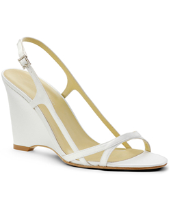 """Delicate straps are placed just-so for a very open, summery look. The shoe is made in your choice of white or ivory fabric and is available in a wide selection of sizes. Heel measures 3.75"""". This fabric is not dyeable."