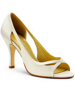 """Such a simple, smart design. With its cut out details and peep-toe you can wear this pump in any season. Made in your choice of white or ivory fabric and available in a wide selection of sizes. Heel measures 3.5"""". This fabric is not dyeable."