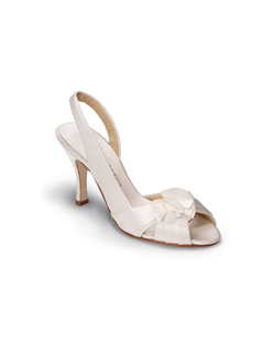 """This shoe has slightly wider straps for structure and comfort but the pleated vamp with ruffle ensures it still has plenty of style. Available in your choice of non-dyeable white or ivory silk satin. Heel measures 3.75""""."