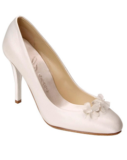 """A group of delicate little flowers with pearl centers is a perfect finishing touch for this simple pump. The shoe comes in your choice of white or ivory silk satin. Heel measures 4"""". Fabric is not dyeable."