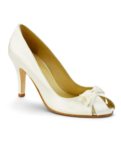 """Dainty gros grain bows grace the vamp of these sophisticated peep toe pumps. Choose white, ivory or champagne silk satin to match your gown beautifully. Heel measures 3.5""""."
