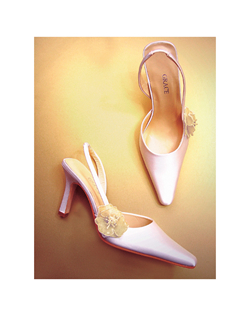 """This elegant white silk satin sllingback is simply embellished with a light gold beaded flower at the side. Slingback is set with elastic so the slip-on style remains comfortable all day. Heel measures 3.5""""."