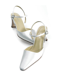 """A great complement to complex gowns in your choice of white or ivory, this simple style performs its duties as a pure classic perfectly. Crafted of silk satin with a rhinestone buckle and 2.5"" heel. This shoe is not dyeable."