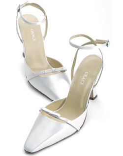 """Graceful silk satin shoes with classic bow strap and 3.25"""" heel make a perfect addition to the simple lines of your traditional gown. This shoe is not dyeable. Available in limited colors and sizes."