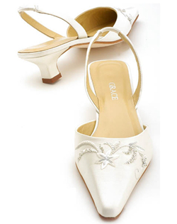"Elegant closed toe sling backs featuring embroidered detailing at the toe. The low stack heel design is perfect for comfort and balance. Comfortable, lightly elasticized sling backs show off a 1.5"" heel with delicate embroidery and intricate beading in your choice of white or ivory fabric"