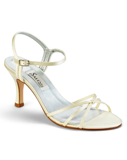 """Simplicity comes in white or ivory silk satin and a great price. Limited availability on metallic silver. The pretty hourglass heel measures 2.75"""", the ankle strap is adjustable with a silver buckle."