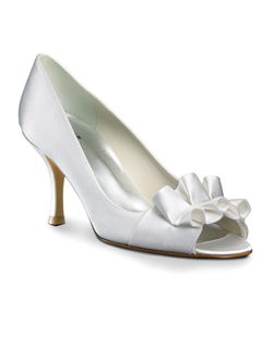 """Absolute sophistication from legendary designer Stuart Weitzman, this peep-toe pump has a flirty ruffle at the toe and a 3"" heel. Made from dyeable white satin."