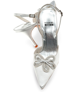 "Legendary shoe designer Stuart Weitzman has done it again with this dramatic shoe in gorgeous dyeable white satin. An elegant satin cutout is embellished with captivatingly clear crystals and a bravura bow. Feel regal in the 3 5/8"""" heels!"