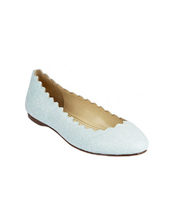 The Dance by Betsey Johnson is a fun yet simple ballet flat. The light blue glitter is fun and perfect for the bride looking for a comfortable blue style. The scalloped edge adds a bit of interest to this sleek ballet flat. Available in light blue glitter.
