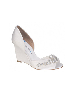 "The David Tutera Winter is a gorgeous wedge design perfect for any outdoor event. The simple design featuring a peep toe front and closed d'orsay back let the crystal accents do all the talking. The heel measures 4"" and is available in white satin."