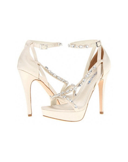 "The David Tutera Cascade sandals are a Ivory satin striking platform design. The platform strappy sandal is updated to a multi-strap detail for interest and D'orsay heel with adjustable ankle strap. The multi directional straps are encrusted in glittering clear Swarovski crystals. The tall 5 1/4"" heel is balanced in the front with a solid 1"" platform"
