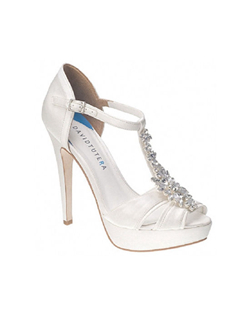 "The David Tutera Jewel shoes are a work of bridal art. This T-strap platform sandal design features a gorgeous crystal cluster accent along the vamp, lightly cushion foot bed and satin materials. The tall 5"" heel is balanced out with a 1"" platform front for comfort and support. The D'orsay heel also features an adjustable ankle strap. Available in White"