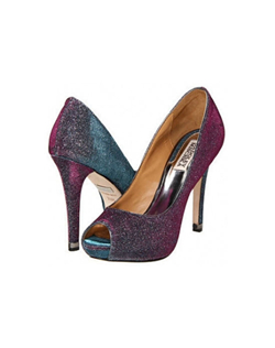 "Stunning multi-tonal peep toe pumps that change color with every step you take. The iridescent fabric goes from turquoise to purple to grey for an all over beautiful effect. The 4.75"" heel is balanced perfectly with a 1/2"" platform front."